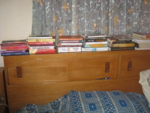 The headpost of my bed, where I read